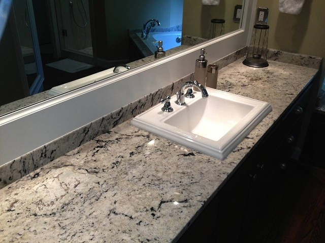 delicatus white granite bathroom countertops - traditional