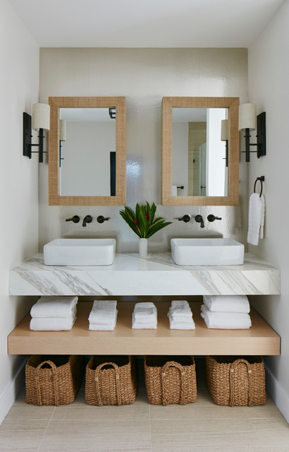 This is an example of a beach style bathroom in Miami with white walls and a vessel sink.