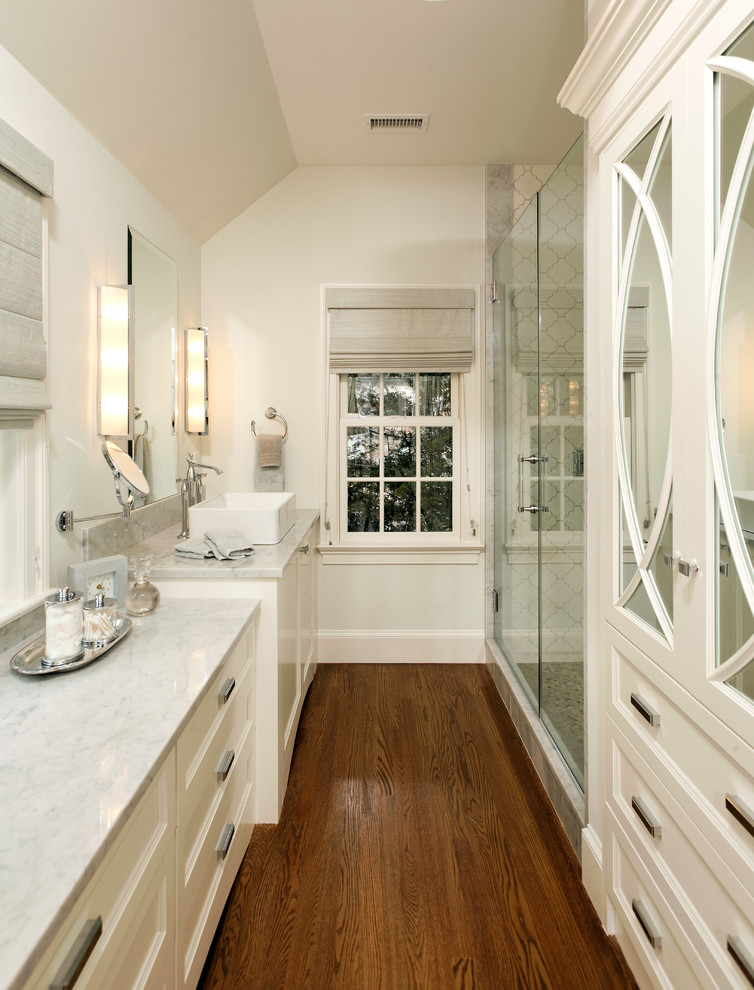 Inspiration for a timeless dark wood floor and brown floor bathroom remodel in DC Metro with a vessel sink