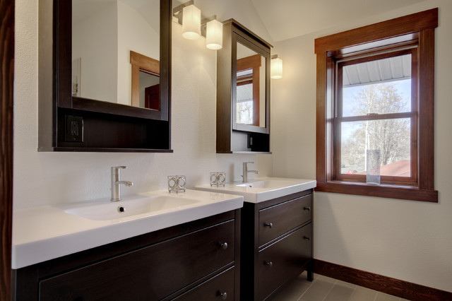 Inspiration for a modern bathroom remodel in Denver with flat-panel cabinets, dark wood cabinets, beige walls and an integrated sink