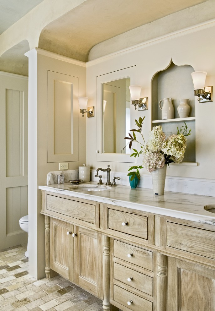 Inspiration for a timeless bathroom remodel in Burlington with marble countertops