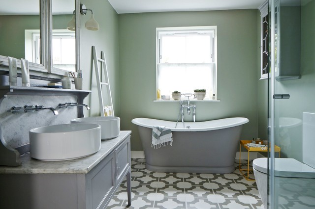 Transitional master white tile freestanding bathtub photo in London with a vessel sink, recessed-panel cabinets, gray cabinets, a two-piece toilet and green walls
