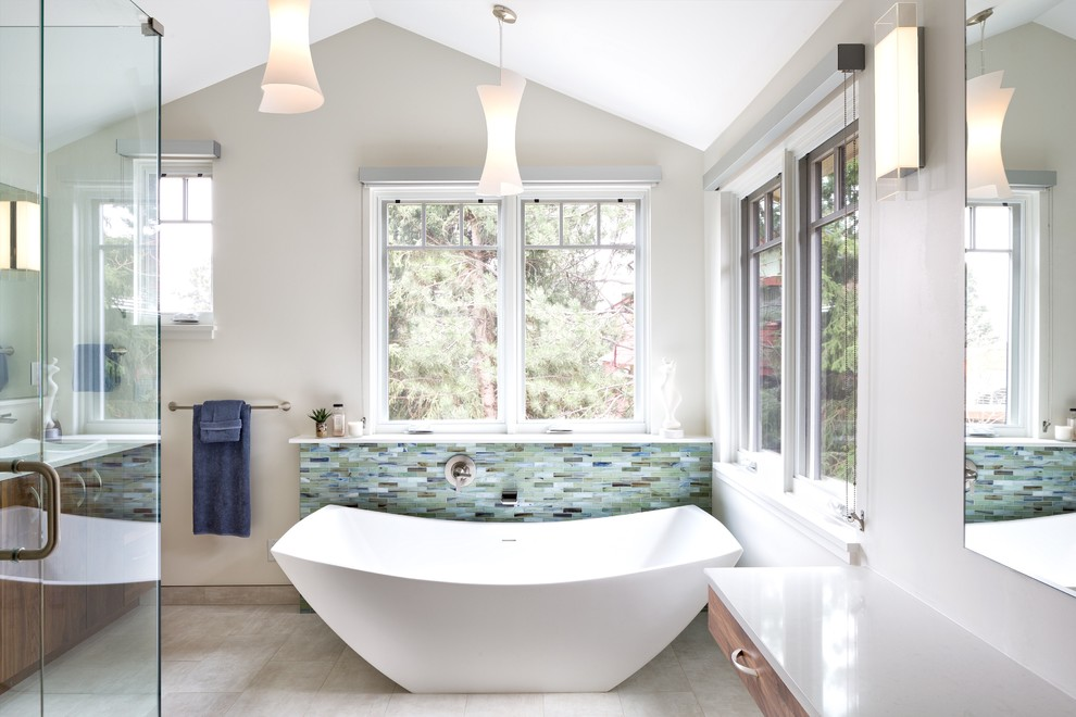Example of a small transitional master blue tile and glass tile porcelain tile and gray floor bathroom design in Denver with flat-panel cabinets, medium tone wood cabinets, white walls, a vessel sink, quartz countertops and a hinged shower door