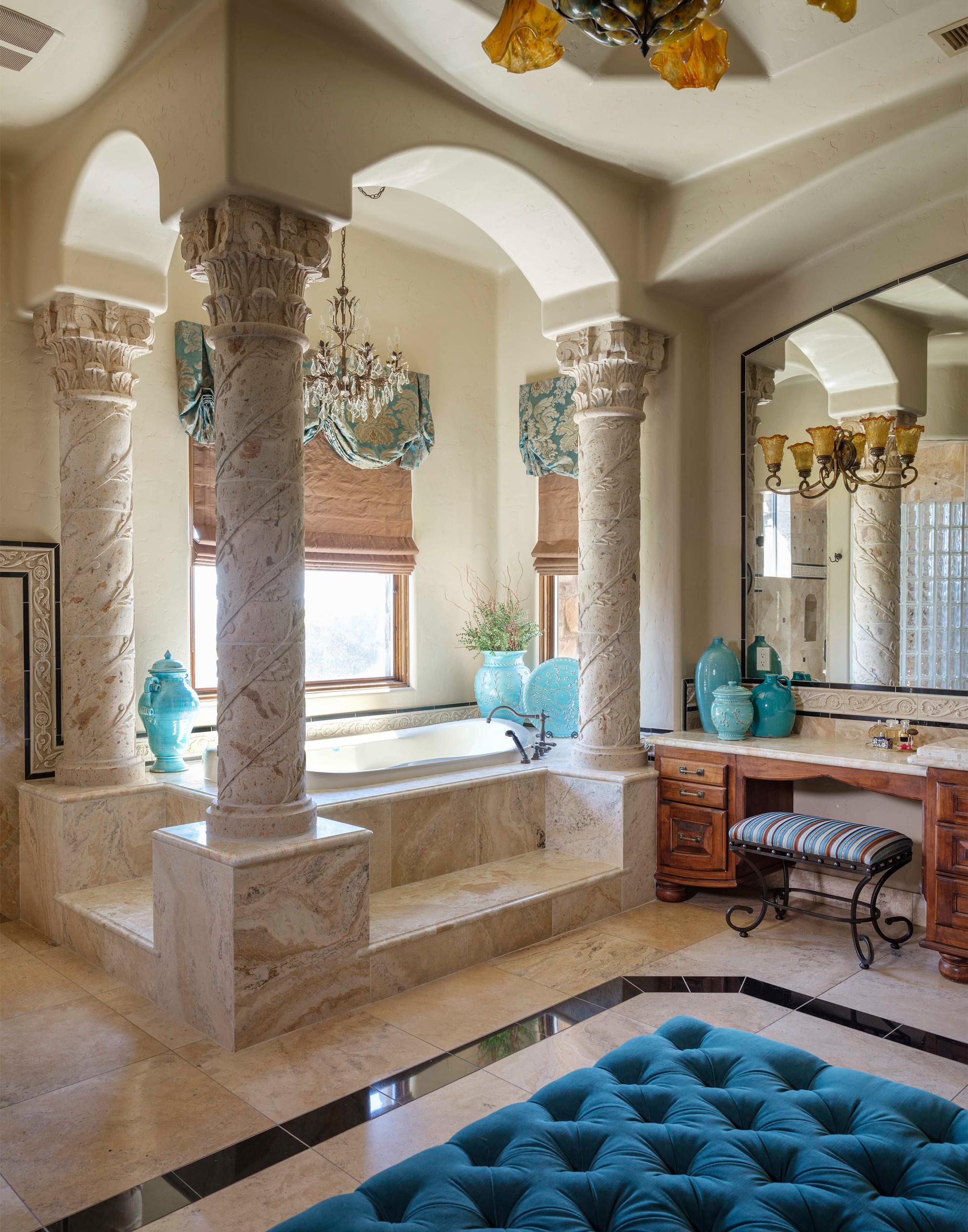 Tuscan beige tile beige floor drop-in bathtub photo in Phoenix with recessed-panel cabinets, medium tone wood cabinets, beige walls and beige countertops