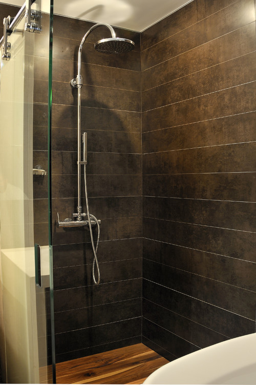The Spa Look Of This Space Is Very Nice. The Shower Floor Is Made Of What  Material? If Wood, How Do You Maintain And Clean? Thanks