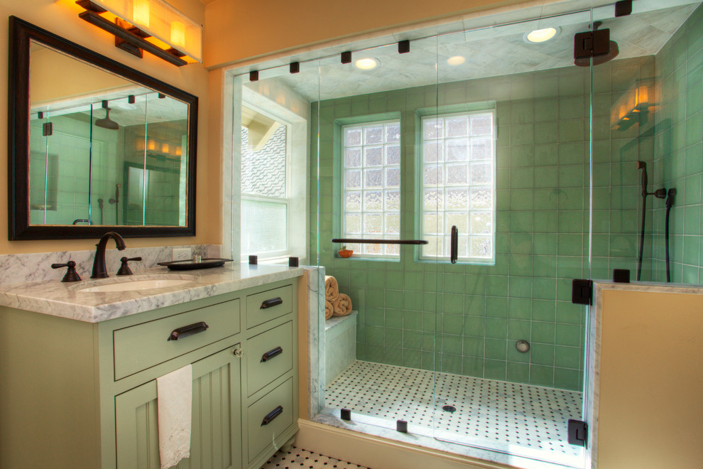 Example of an arts and crafts green tile multicolored floor bathroom design in Sacramento with an undermount sink, flat-panel cabinets, green cabinets and gray countertops