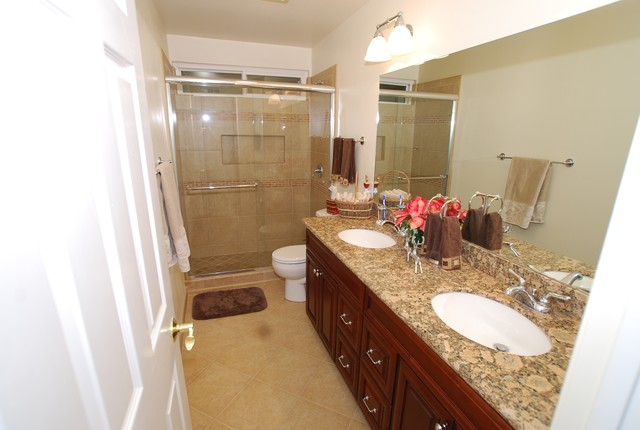 double sink vanity with porcelain tile shower recessed shampoo shelf traditional bathroom - Bathroom Remodel Double Sink