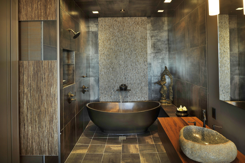 Inspiration for an asian mosaic tile freestanding bathtub remodel in Nashville with a vessel sink, wood countertops and brown countertops