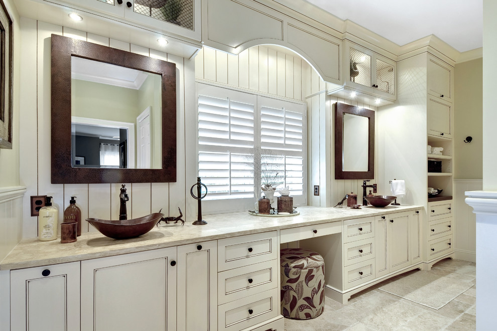 Inspiration for a large transitional master beige tile ceramic tile bathroom remodel in Charleston with a vessel sink, recessed-panel cabinets, white cabinets and beige walls
