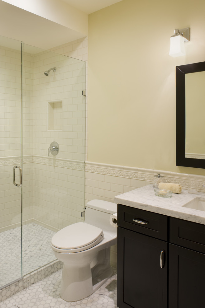 Example of a trendy subway tile bathroom design in San Francisco with marble countertops