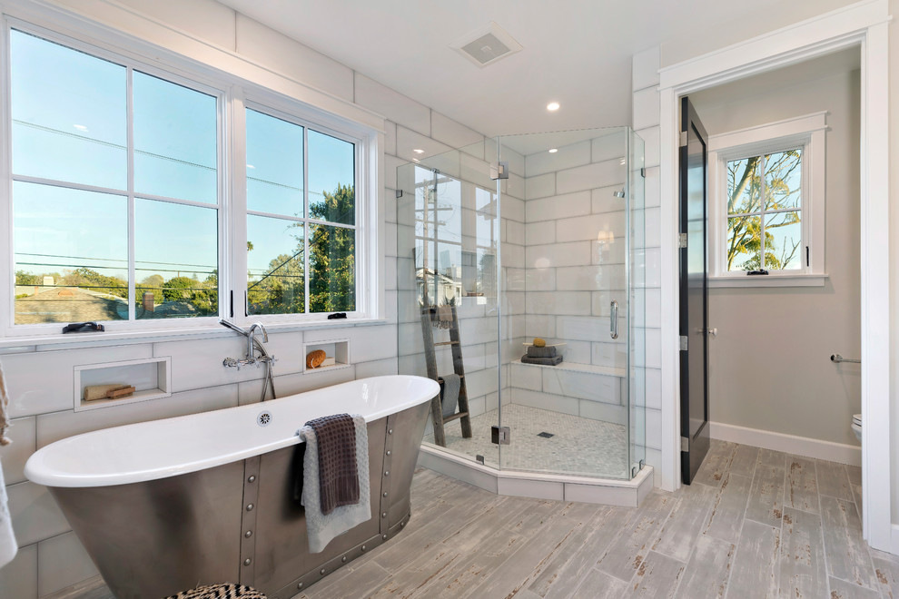 Inspiration for a country master white tile gray floor bathroom remodel in Los Angeles with gray walls and a hinged shower door