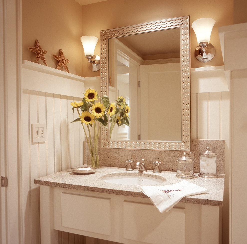 Example of a beach style bathroom design in Portland Maine with granite countertops