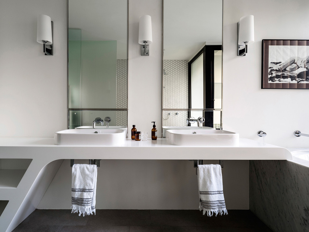 Inspiration for a contemporary bathroom in Sydney with an undermount tub, white walls and a drop-in sink.