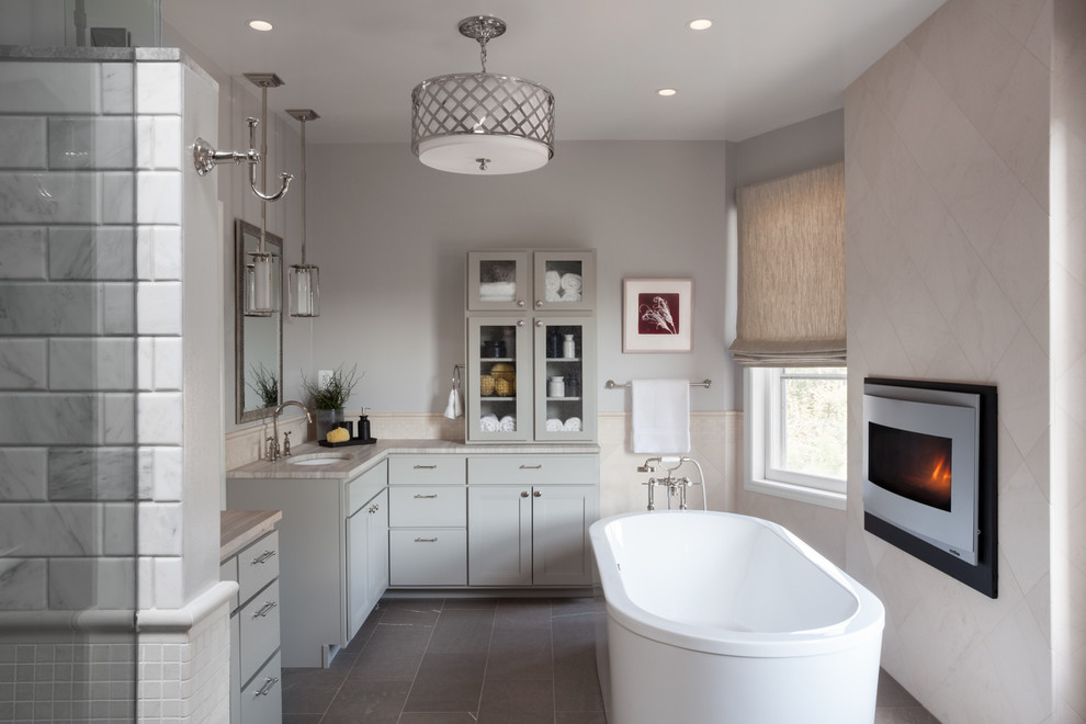 Inspiration for a large transitional master white tile and marble tile slate floor and gray floor bathroom remodel in DC Metro with an undermount sink, shaker cabinets, gray cabinets, gray walls, soapstone countertops and a hinged shower door
