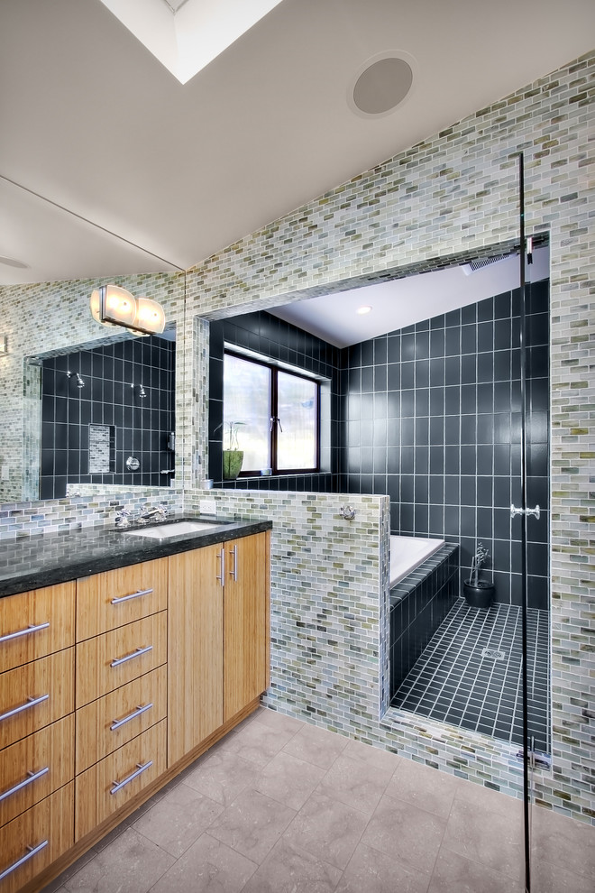 Example of a trendy multicolored tile bathroom design in Seattle with an undermount sink, flat-panel cabinets and medium tone wood cabinets