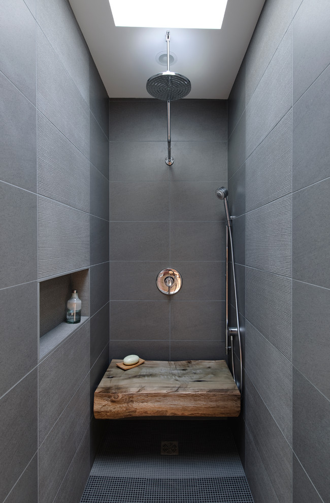 Example of an urban gray tile bathroom design in Seattle