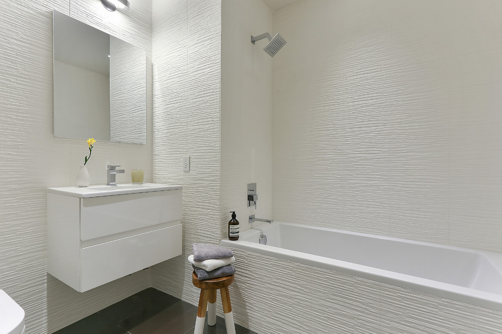 Bathroom - contemporary white tile bathroom idea in New York with flat-panel cabinets and white cabinets