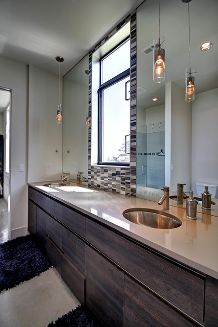 Trendy master multicolored tile bathroom photo in Boise with flat-panel cabinets, dark wood cabinets, beige walls and an undermount sink