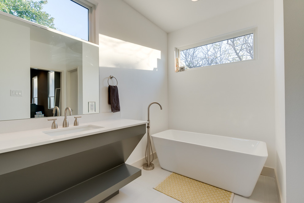 Inspiration for a contemporary freestanding bathtub remodel in Dallas with white countertops