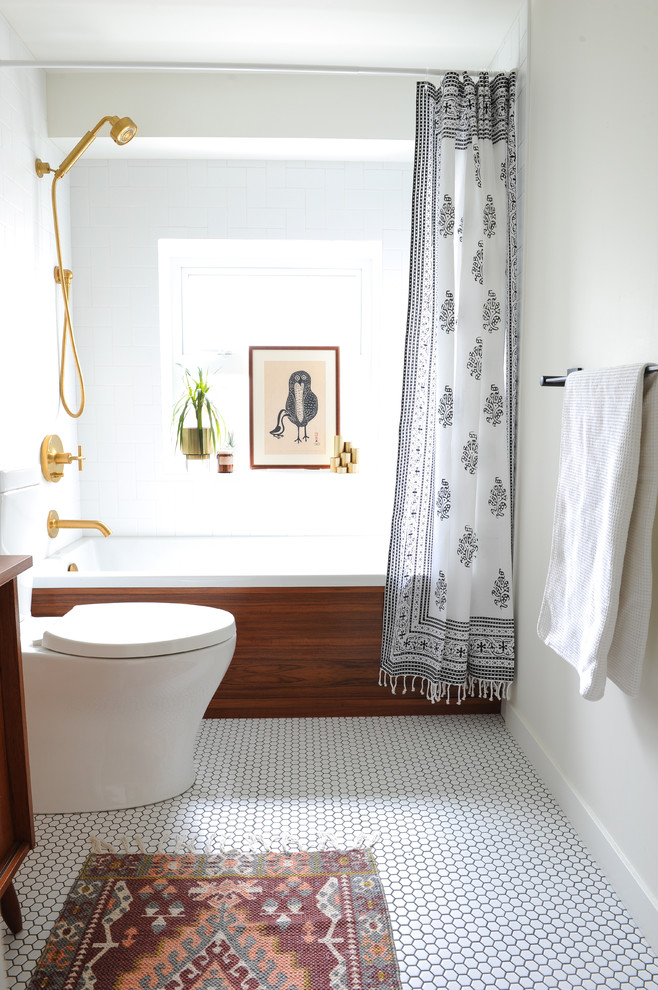 Bathroom - small 1960s master white tile and ceramic tile porcelain tile and white floor bathroom idea in Vancouver with flat-panel cabinets, medium tone wood cabinets, a two-piece toilet, white walls and wood countertops