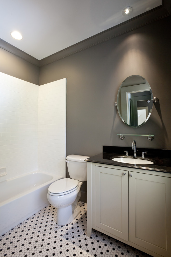 Inspiration for a timeless white tile bathroom remodel in Atlanta with an undermount sink, shaker cabinets, gray cabinets and a two-piece toilet