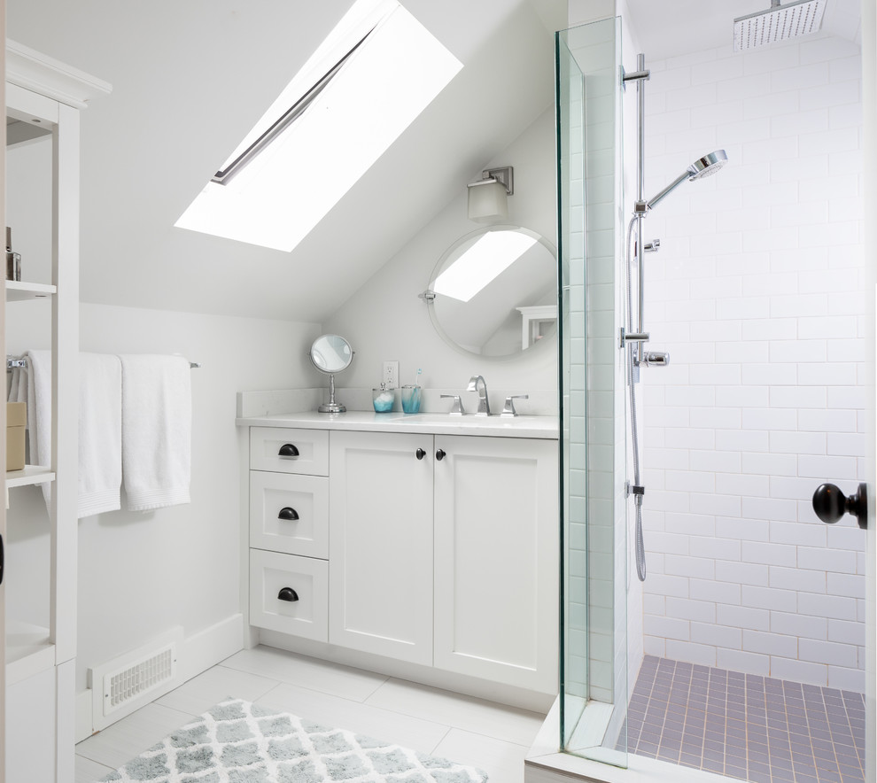 Example of a small transitional white tile and subway tile white floor corner shower design in Vancouver with shaker cabinets, white cabinets, an undermount sink and white countertops