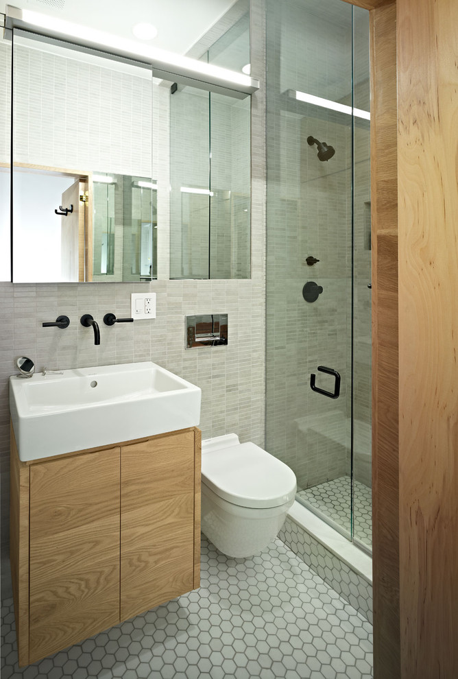 Inspiration for a contemporary bathroom remodel in New York with an integrated sink