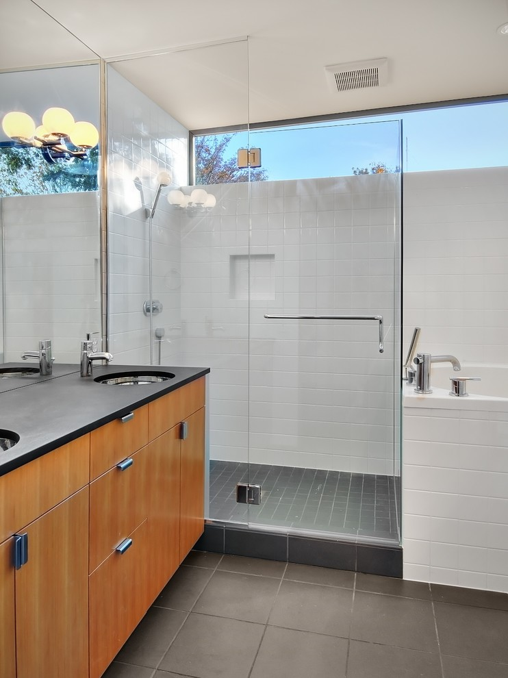 Example of a trendy white tile bathroom design in Seattle with an undermount sink, flat-panel cabinets and medium tone wood cabinets