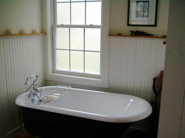 eclectic bathroom Coastal bath tub with bead board