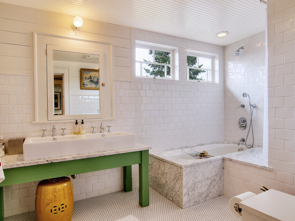 Tub/shower combo - eclectic white tile and subway tile tub/shower combo idea in Seattle with a trough sink, green cabinets and an undermount tub