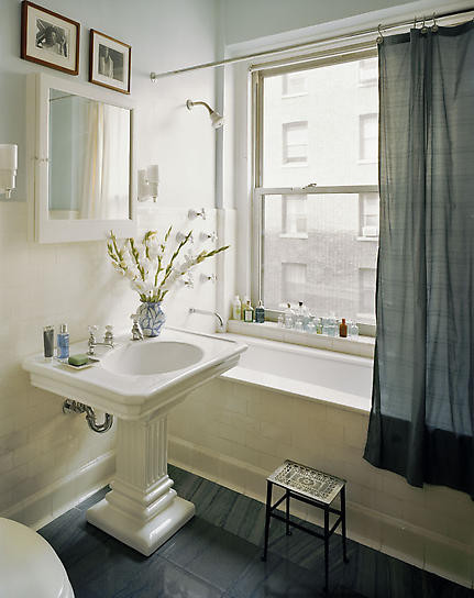 When Decorating A Small Bathroom Opt For Light Color On The Walls To Give Room Feeling Of E White Framed Mirror Above Pedestal Sink Gives