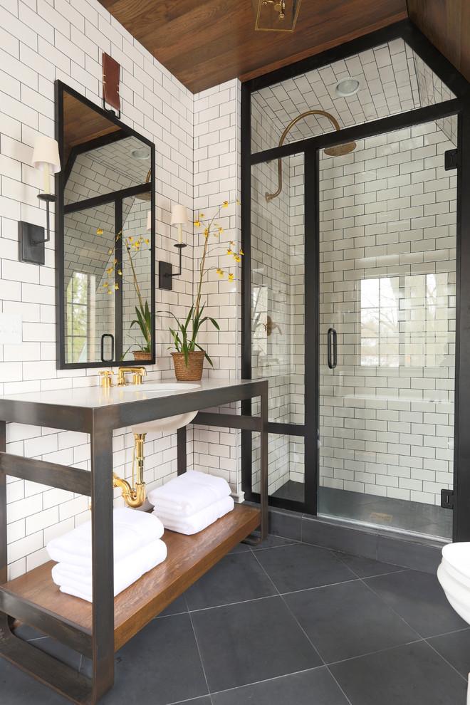 Inspiration for a transitional subway tile black floor bathroom remodel in Chicago