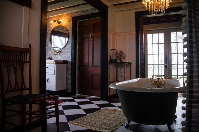Bathroom - large cottage master black and white tile and ceramic tile ceramic floor and black floor bathroom idea in Austin with furniture-like cabinets, a one-piece toilet, pink walls, a vessel sink, wood countertops and brown countertops