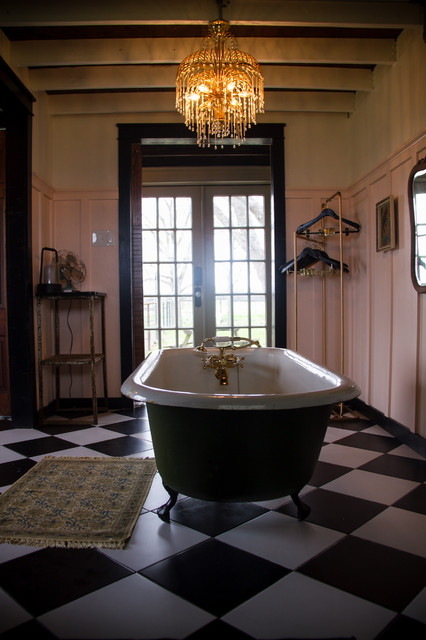 Example of a large cottage master black and white tile and ceramic tile ceramic floor and black floor bathroom design in Austin with furniture-like cabinets, a one-piece toilet, pink walls, a vessel sink, wood countertops and brown countertops