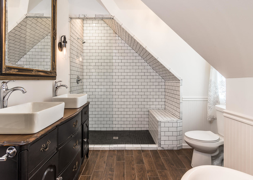 Example of a mid-sized eclectic master black and white tile and porcelain tile porcelain tile and brown floor alcove shower design in Nashville with a vessel sink, black cabinets, wood countertops, a two-piece toilet, white walls and brown countertops