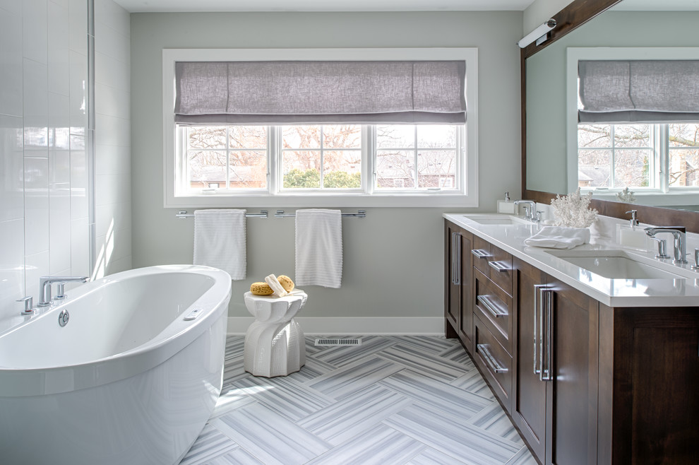 Inspiration for a transitional multicolored tile freestanding bathtub remodel in Minneapolis with shaker cabinets and dark wood cabinets