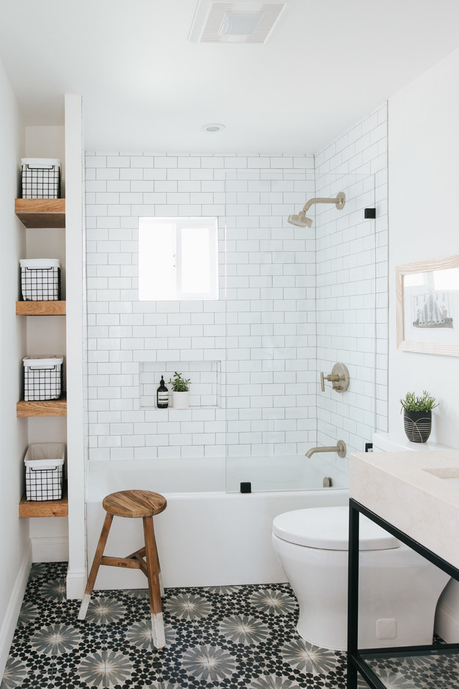 Bathroom - mid-sized contemporary kids' white tile and porcelain tile cement tile floor and multicolored floor bathroom idea in Other with open cabinets, a two-piece toilet, white walls, marble countertops, beige countertops, an undermount sink and a niche