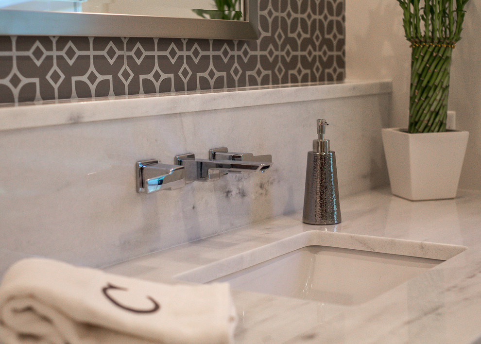 Bathroom - huge transitional master brown tile, white tile and ceramic tile marble floor and multicolored floor bathroom idea in Dallas with furniture-like cabinets, white cabinets, white walls, an undermount sink, marble countertops, a hinged shower door and white countertops