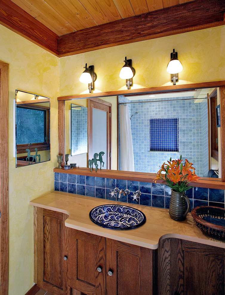 Example of a tuscan bathroom design in DC Metro with a drop-in sink, wood countertops, yellow walls and beige countertops