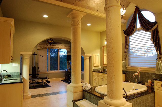 Elegant bathrooms in the Texas Hill Country by Stadler Custom Homes mediterranean bathroom