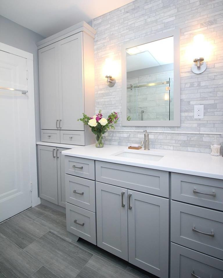 Small transitional master gray tile and mosaic tile ceramic tile doorless shower photo in Boston with shaker cabinets, gray cabinets, a two-piece toilet, gray walls, an undermount sink and quartz countertops