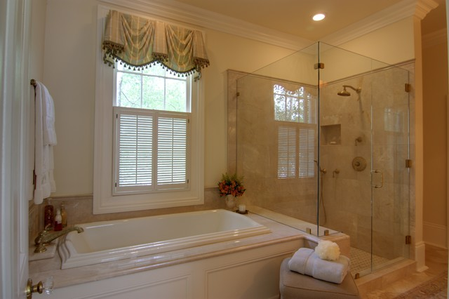 elegant master bathroom with custom cabinetry lighting