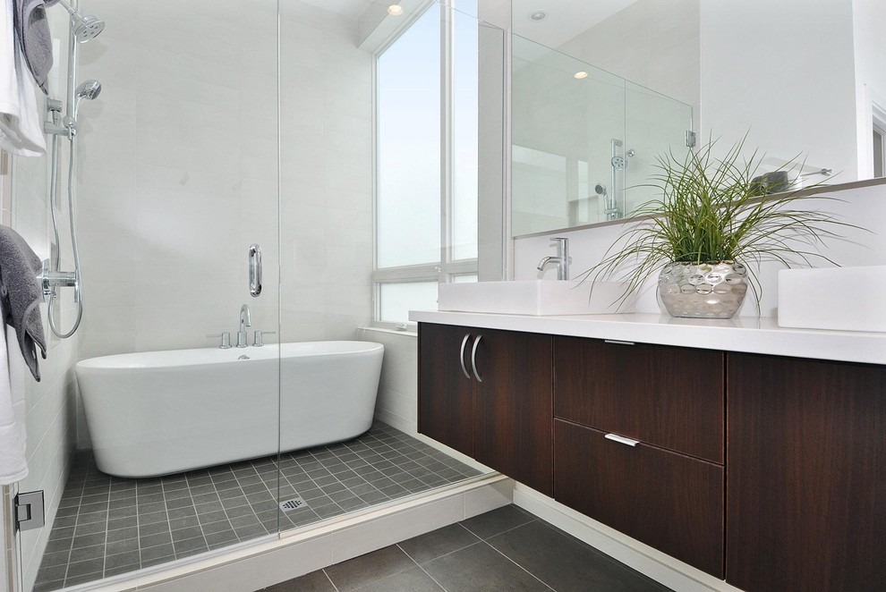 Bathroom - mid-sized contemporary master porcelain tile porcelain floor bathroom idea in Seattle with a vessel sink, flat-panel cabinets, dark wood cabinets, white walls and engineered quartz countertops