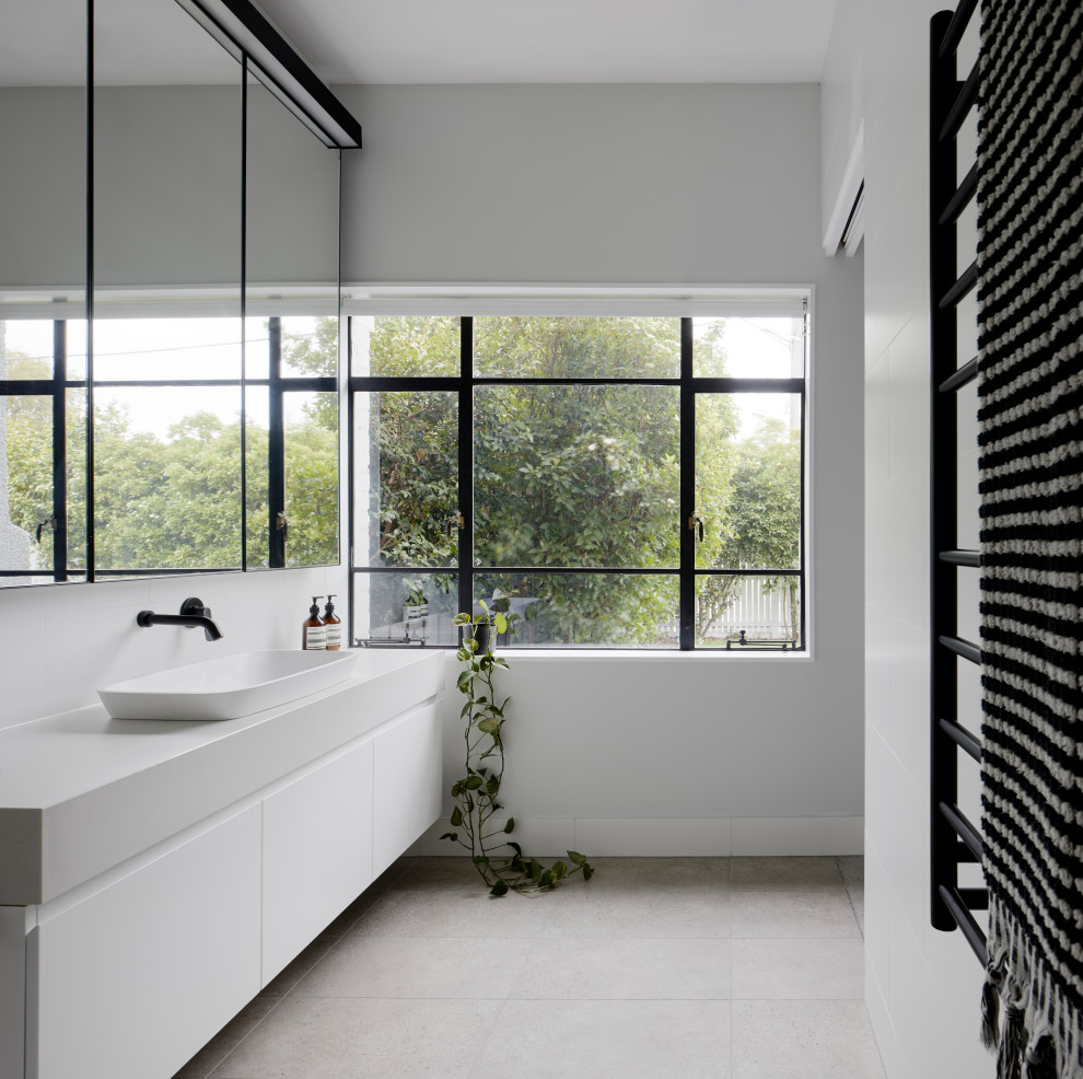 Inspiration for a contemporary white tile and porcelain tile porcelain tile, single-sink and gray floor bathroom remodel in Melbourne with quartz countertops, a floating vanity, flat-panel cabinets, white cabinets, white walls, a vessel sink and white countertops