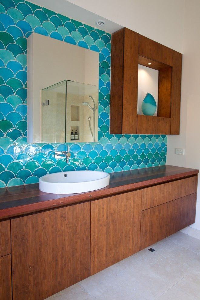 Bathroom - contemporary bathroom idea in Melbourne with a vessel sink and wood countertops