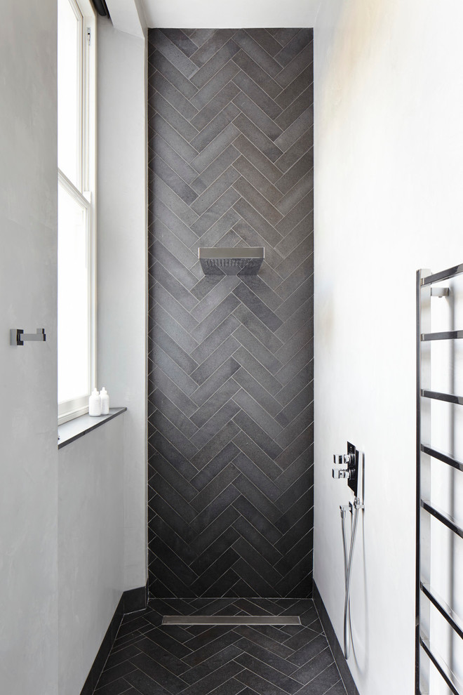 Example of a trendy gray tile bathroom design in London