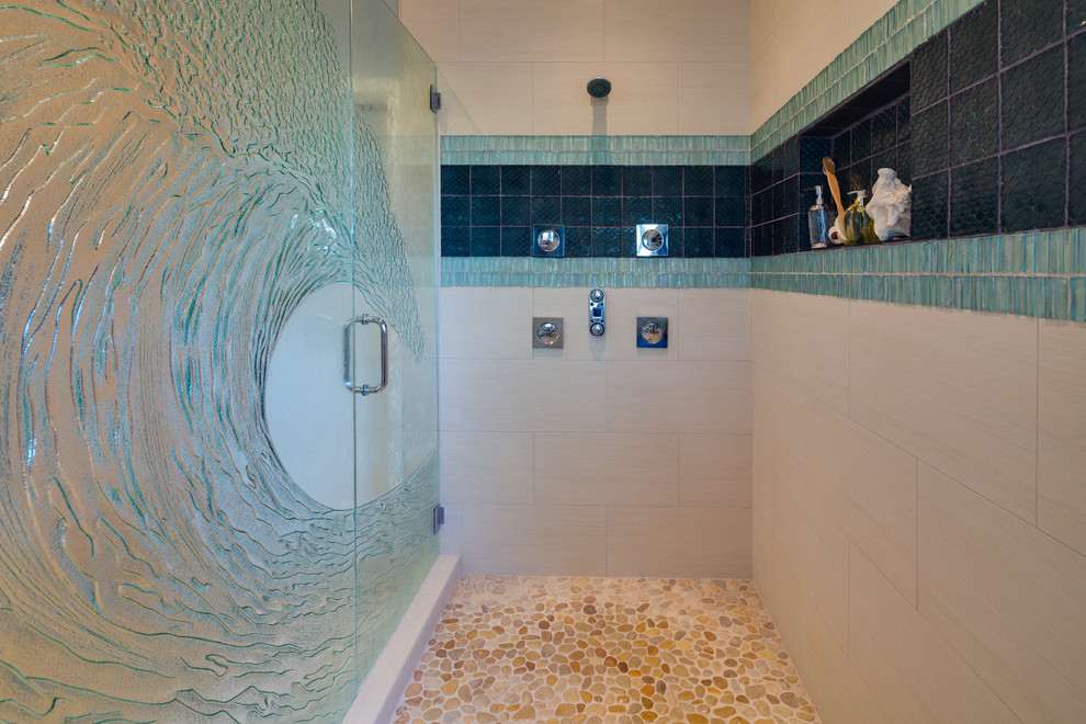Example of a trendy multicolored tile pebble tile floor alcove shower design in San Diego