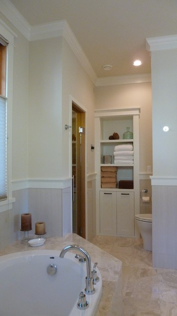 Example of a mid-sized arts and crafts bathroom design in Vancouver with shaker cabinets and white cabinets