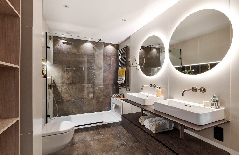 Bathroom - mid-sized contemporary master brown tile and porcelain tile porcelain tile, brown floor and double-sink bathroom idea in Cardiff with open cabinets, dark wood cabinets, a wall-mount toilet and beige walls