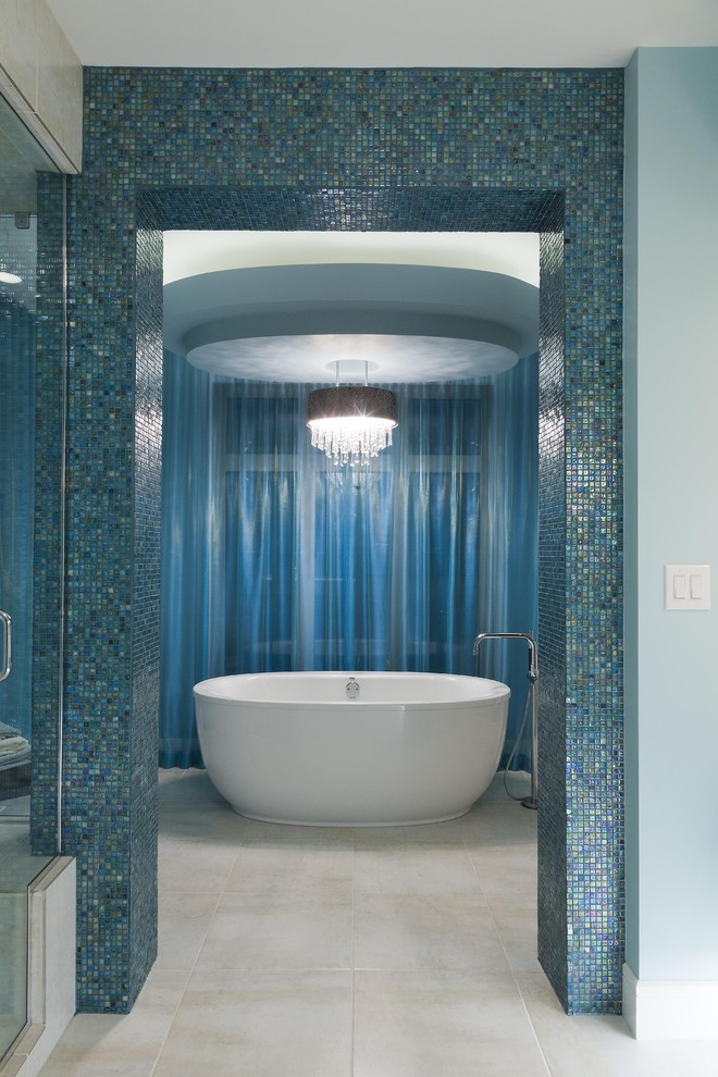 Inspiration for a contemporary blue tile and mosaic tile freestanding bathtub remodel in Other
